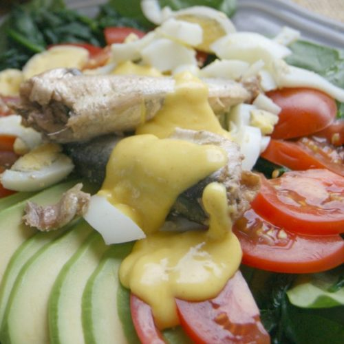 Spinach and Sardine Breakfast Salad with Hollandaise Sauce