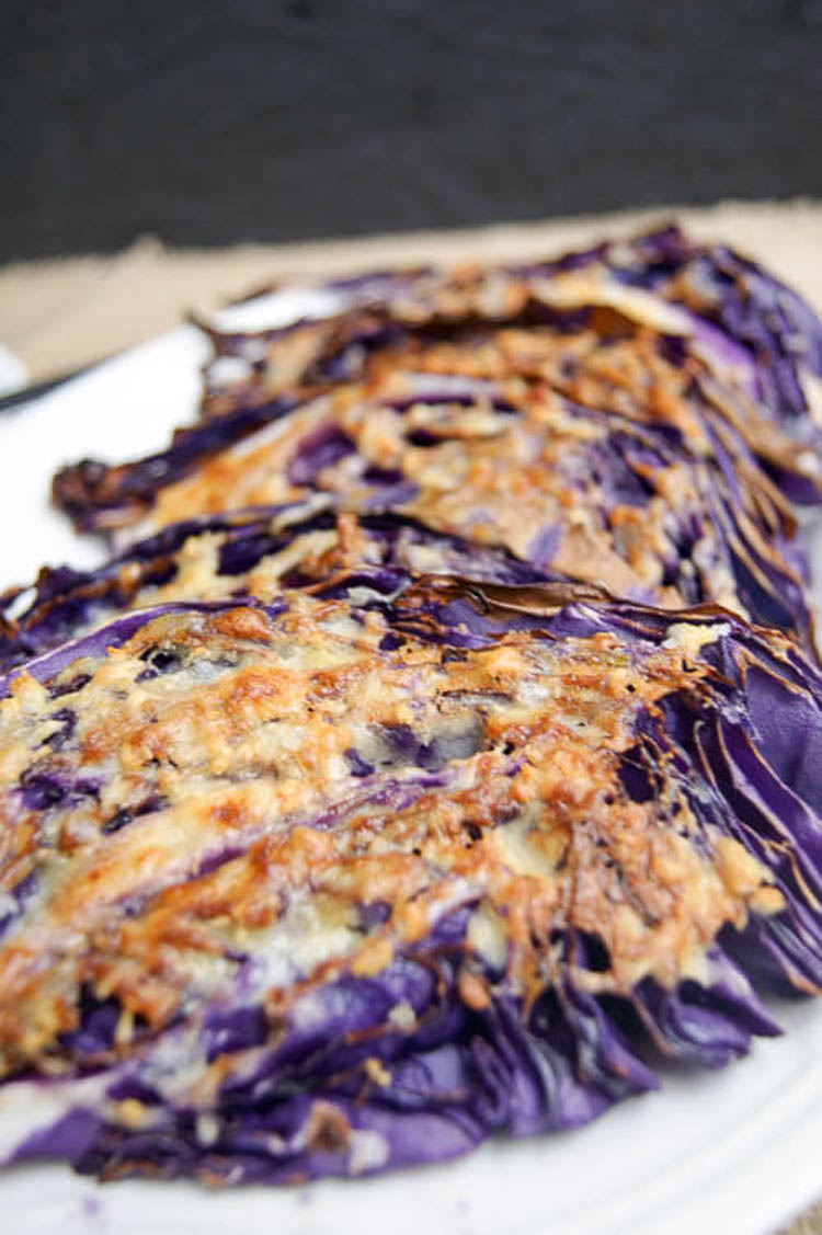 Parmesan & Garlic Cabbage Steaks - With only four ingredients, this primal and paleo-ish side dish is always a winner. It's also budget friendly and simple to throw together for a last minute addition. #paleoish #cabbage #healthy #easyside