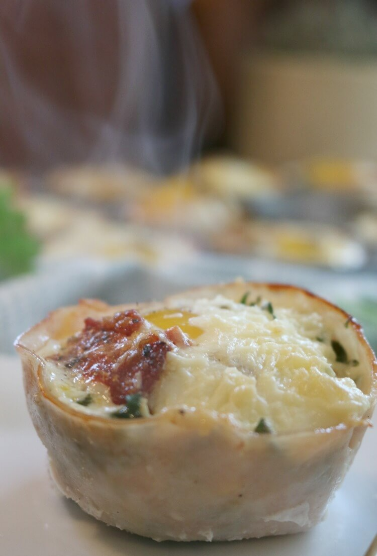 Breakfast Kale Egg Cups with Parmesan and Sun Dried Tomatoes - Great as a quick grab-n-go breakfast (from the freezer) or a nice staple at a relaxing brunch. Click to find this easy recipe!