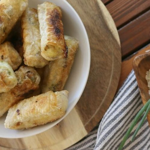 Spring Rolls with Rice & Eggs - These Spring Rolls with Rice and Eggs makes a fun and filling appetizer. Stuffed with fragrant basmati rice, hard boiled eggs and garden green onions. Cooked in a healthy fat, you won't be able to stop at just one.
