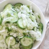 Cabbage and Cucumber Salad - This cabbage salad is seriously loaded with crunch, zest and deliciousness. Made with simple ingredients and has a longer shelf life than most salads, this salad is a fun party food.
