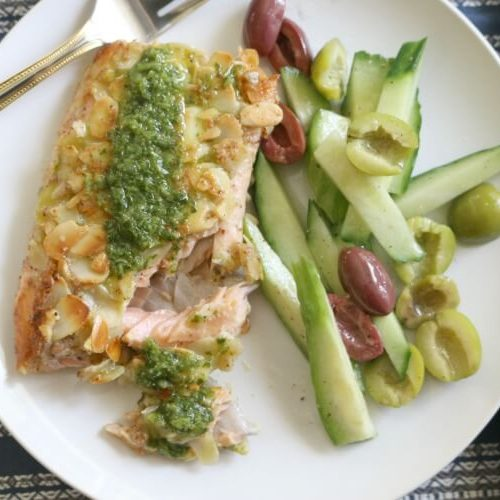 Almond Crusted Trout with Chermoula and Cucumber Olive Salad - This naturally gluten free meal can be brought together in 40 minutes. Delicious and complete meal that is paleo and whole30.