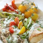 Mahi Mahi on Sprouted Grains Bowl -Oven-baked and paprika-seasoned Mahi Mahi fillets on a bed of sprouted grains, roasted bell peppers and drizzled with Lime-Yogurt Dressing makes for an easy weeknight meal or special dinner.