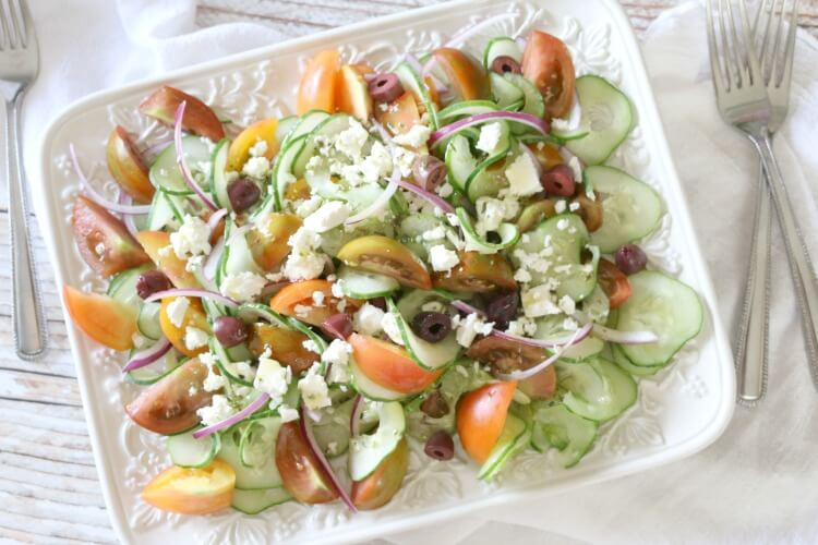 Greek Tomato & Cucumber Salad - This Greek Tomato and Cucumber Salad has all the robust Mediterranean flavors but without the leafy greens. Just a handful of simple ingredients, yet delicious and boasts a simple Greek salad dressing.