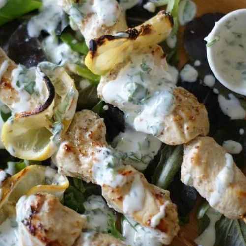 Coriander Chicken Kebabs with Cilantro Kefir Sauce - Tender and juicy, these oven-baked Coriander Chicken Kebabs are perfect on a bed of rice (or greens for low-carb) and topped with Cilantro Kefir Sauce for extra probiotics and flavor. Gluten Free   Primal   Cultured   GAPS diet