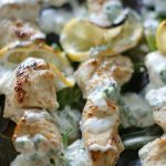 Coriander Chicken Kebabs with Cilantro Kefir Sauce - Tender and juicy, these oven-baked Coriander Chicken Kebabs are perfect on a bed of rice (or greens for low-carb) and topped with Cilantro Kefir Sauce for extra probiotics and flavor. Gluten Free | Primal | Cultured | GAPS diet