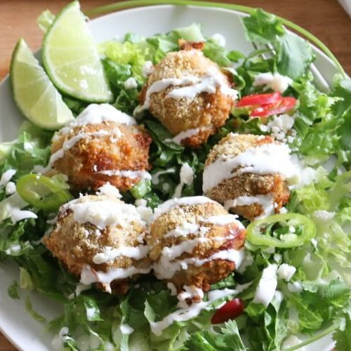 Turkey Fajita Meatballs - #ad Tender and flavorful from the onions and bell peppers, these Turkey Fajita Meatballs are quick and easy to put together for an lazy weeknight meal. Enjoy on a bed of romaine lettuce (or rice!) drizzled with crema fresca and topped with Cotija cheese.