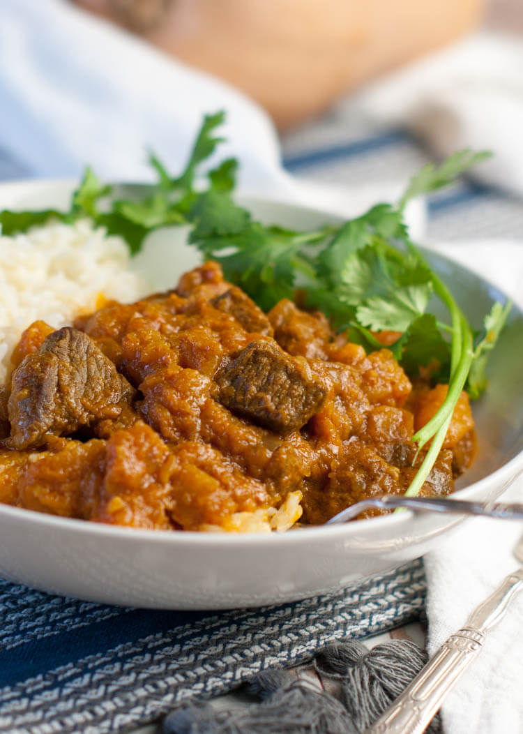 Lamb and Butternut Squash Curry made in the electric pressure cooker (Instant Pot) starts with tender grass-fed lamb, diced butternut squash, creamy coconut milk, and loads of curry flavor. Naturally #paleo, #whole30, and #GAPS for optimal nutrition. #instantpot #cleaneating
