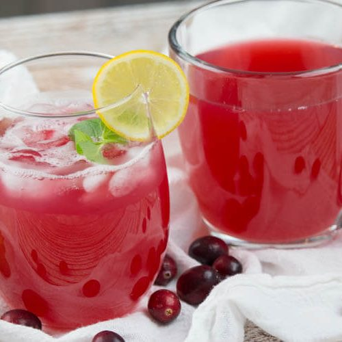 glass and mug of cranberry juice, iced and hot respectively