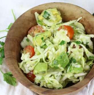 Avocado Cabbage Slaw - Enjoy this as a side salad next to a healthy protein or add some to your favorite tacos. It's rich in healthy fats, yummy crunch and loads of flavor. #lowcarb #paleo #whole30