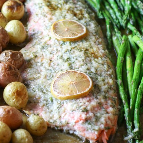 Sheet Pan Garlic Butter Salmon, Asparagus & Potatoes Sheet Pan - A complete meal on one pan - full of flavor and easy toput together. Can be customizable to fit your dietary needs for Whole30, Paleo, or Low Carb.#sheetpan #onepan #salmon