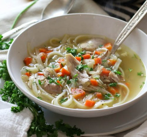 Nourishing Chicken Noodle Soup (Gluten Free, Paleo suggestions!) - Nourishing and full of detoxifying properties, this Gluten-Free Chicken Noodle Soup is made easilywith just 8 ingredients. Make this grain-free (paleo, keto, low-carb) and use vegetable noodles. #glutenfree #chickennoodlesoup