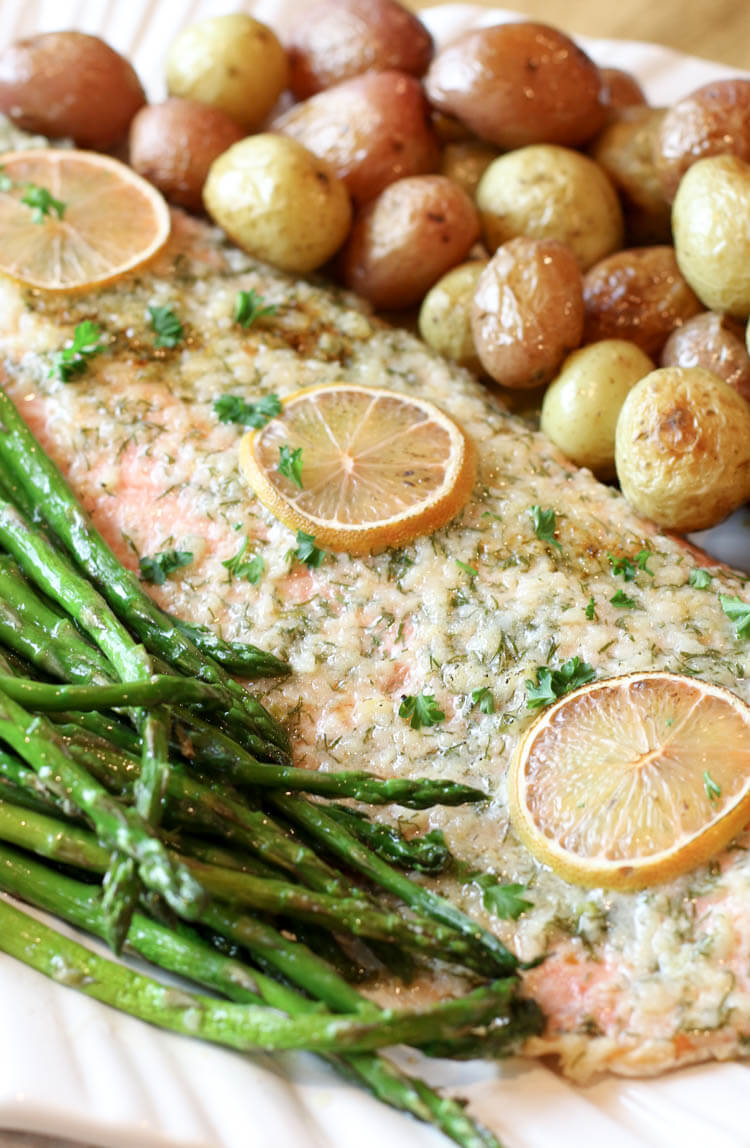 Garlic Butter Salmon, Asparagus & Potatoes Sheet Pan - A complete meal on one pan - full of flavor and easy to put together. Can be customizable to fit your dietary needs for Whole30, Paleo, or Low Carb. #sheetpan #onepan #salmon