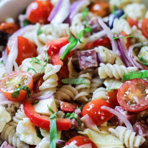 Healthy Gluten-Free Pasta Salad (Paleo, Low Carb & Whole30 options) -A hearty mix of gluten-free pasta, diced salami, tomatoes, artichoke hearts, feta cheese, all wrapped in an easy yet delicious zesty dressing. #healthy #pastasalad #whole30