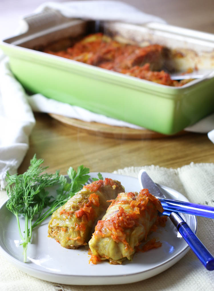 Healthy Classic Stuffed Cabbage Leaves (Paleo-ish) - Stuffed cabbage leaves is the ultimate comfort food.  Easy ground meat and rice filling wrapped in cabbage leaves, topped with flavorful tomato sauce and baked to tender perfection! #cabbage #paleo #healthy