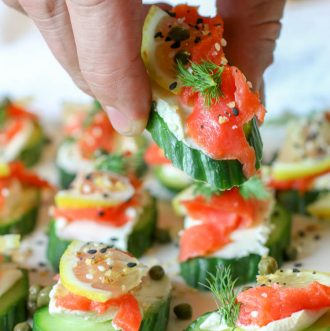Everything Bagel Cucumber Bites with Smoked Salmon (Low Carb, GAPS, Primal) - Healthy smoked salmon on top of cream cheese topped cucumber slices and finished off with Everything Bagel Seasoning. A delicious, super easy, 15 minute, low-carb appetizer.#lowcarb #appetizers #smokedsalmon