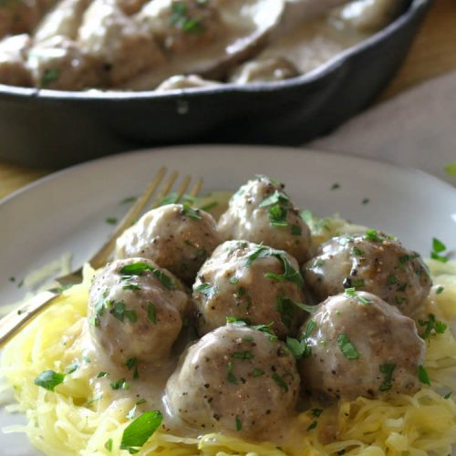 Oven-Baked Swedish Meatballs (Paleo, Whole30) - These Paleo Swedish Meatballs are just as satisfying as the original comfort food but without the gluten or dairy. They come together easily, baked to perfection in the oven, and then smothered in the delicious gluten-free gravy. #whole30 #meatballs