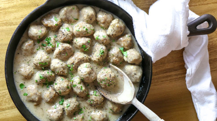 Oven-Baked Swedish Meatballs (Paleo, Whole30) - These Paleo Swedish Meatballs are just as satisfying as the original comfort food but without the gluten or dairy. They come together easily, baked to perfection in the oven, and then smothered in the delicious gluten-free gravy. #whole30 #ovenbaked