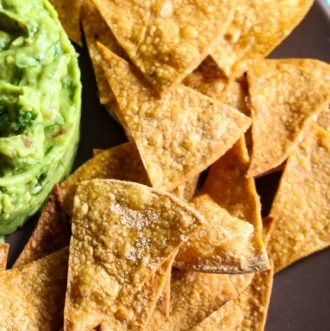 How to Make Healthy Tortilla Chips - 2 Ingredients! Check out how easy it is to make healthy, homemade tortillas that requires only 2 ingredients and 15 minutes of your time. Great to dip into chunky guacamole or pico de gallo. #homemadechips #tortillachips