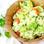 The BEST Avocado Cabbage Slaw - crunchy raw cabbage, seasonal tomatoes and creamy avocados make the best slaw. It's paleo, whole30 and keto too! #lowcarb #rawcabbage