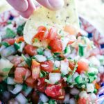Fermented Tomato Salsa - Fermented Tomato Salsais a tangy and gut-healing version of Pico de Gallo. With only 5 ingredients and naturally Paleo, Whole30, and Low Carb, this will be your favorite condiment all season long. #ferment #paleo