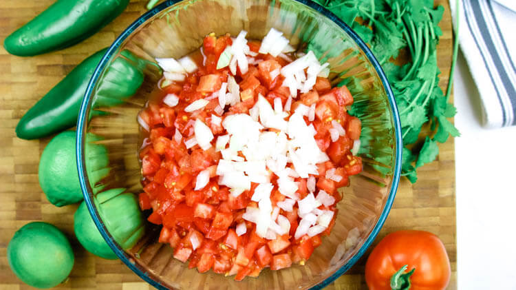 Fermented Pico de Gallo - Fermented Tomato Salsa is a tangy and gut-healing version of Pico de Gallo. With only 5 ingredients and naturally Paleo, Whole30, and Low Carb, this will be your favorite condiment all season long. #ferment #healthy