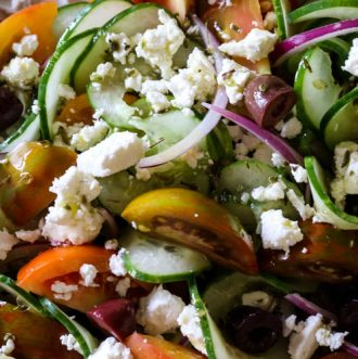Greek Tomato & Cucumber Salad (Low Carb, Primal, GAPS) -This Greek Tomato and Cucumber Salad with or without feta cheese has all the robust Mediterranean flavors. With a simple 4-ingredient salad dressing, this salad can be made in 15 minutes. #healthysalad #greeksalad