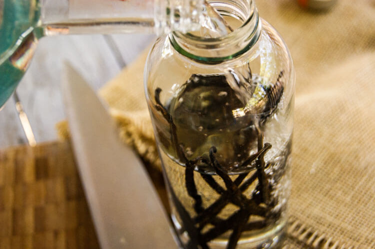 Vodka is poured over vanilla beans to make vanilla bean extract.