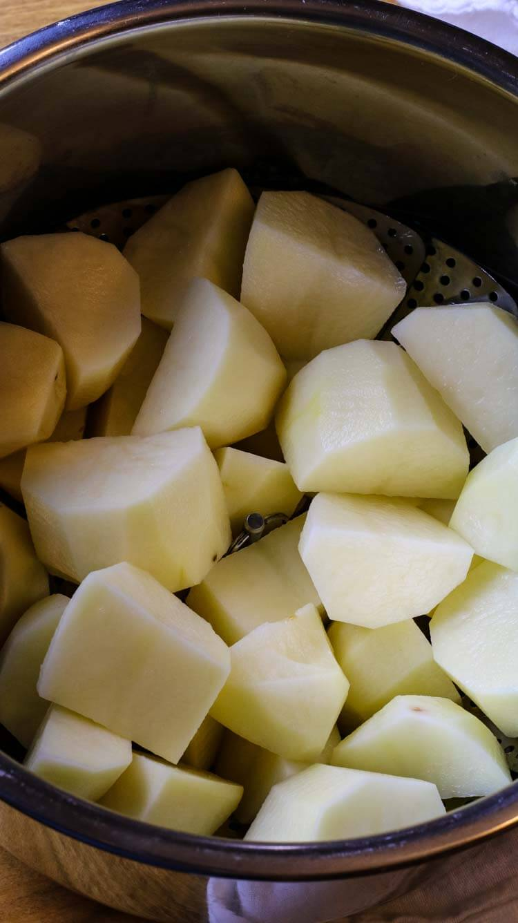 Peeled and cut russet potatoes in Instant Pot liner.
