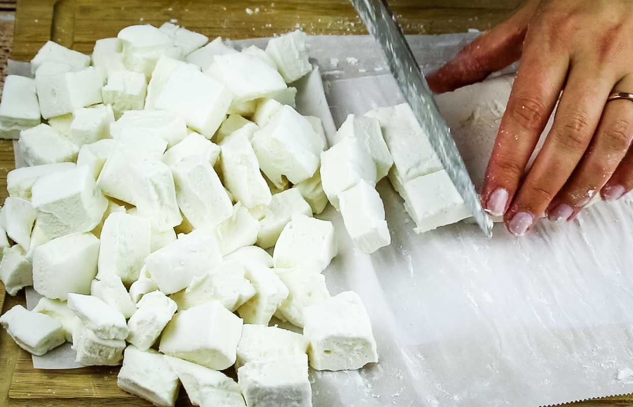Cutting homemade marshmallows in action.
