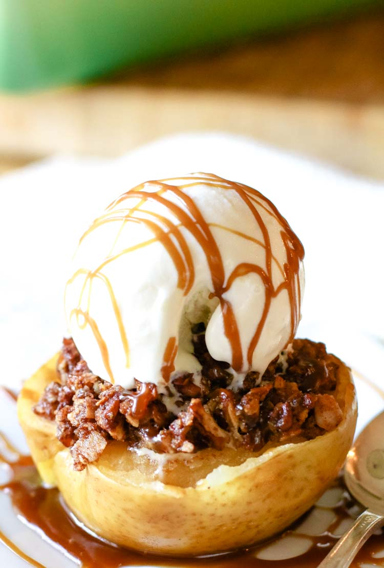 Apple halves topped with pecan crumble and ice cream scoop