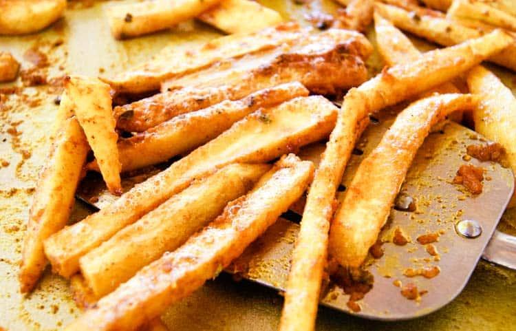 Sweet potato fries on a wide spatula