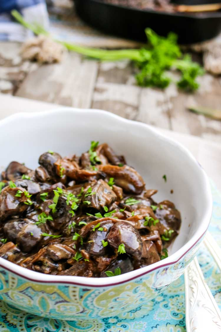 Creamy mushrooms with parsley garnish