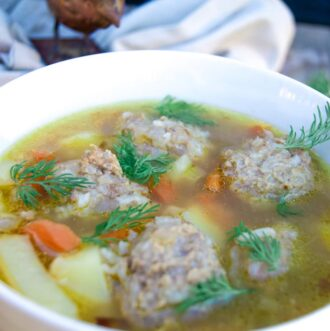 Meatball soup with potatoes, chicken meatballs, carrots and fresh dill