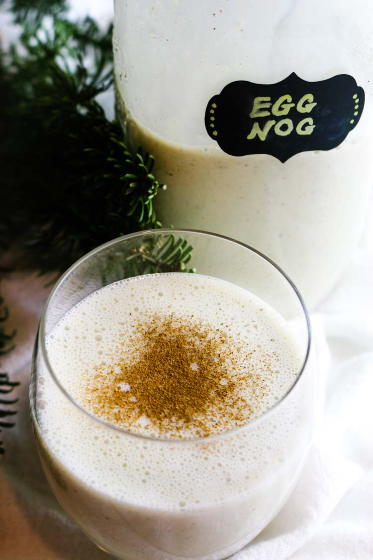 Homemade eggnog in a glass and in a jar