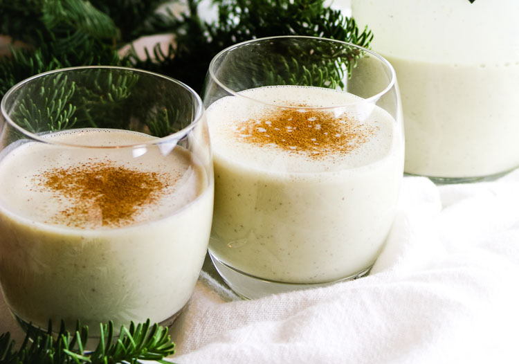 Healthy homemade eggnog in glasses with nutmeg sprinkled