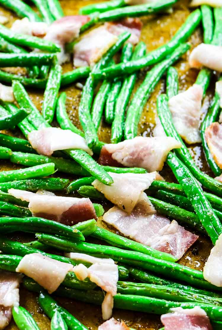 Green beans on a sheet pan with added bacon
