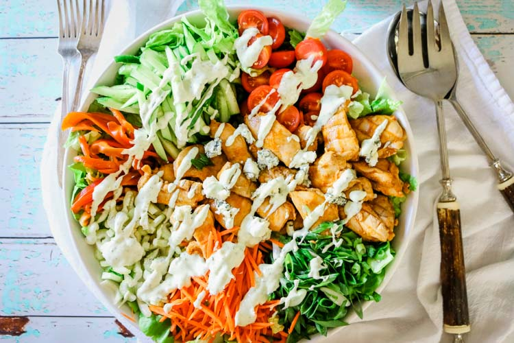 Blue cheese crumbles on top of Buffalo Chicken Salad