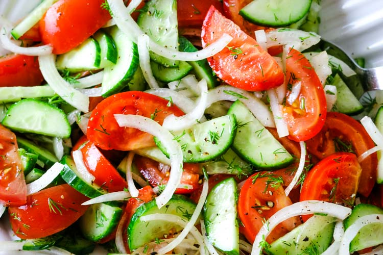 Tomatoes, cucumbers, and onions with fresh dill