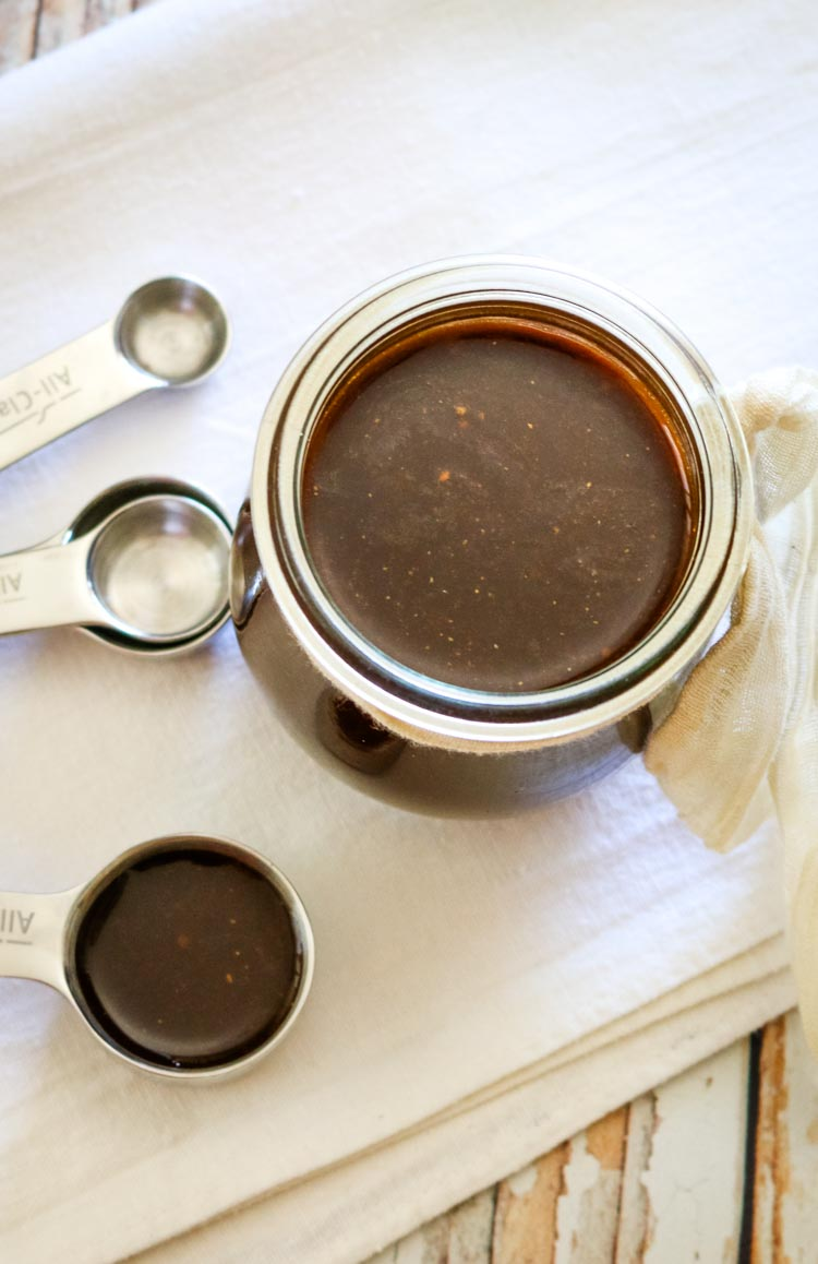 Healthy homemade worcestershire sauce in a small weck jar and measuring spoon